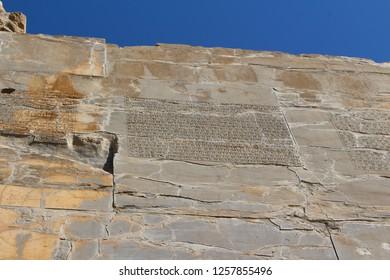 Persepolis, Iran - April 2016.  Writings in cuneiform on the walls of Persepolis