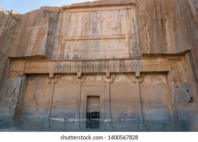 Persepolis, Iran - June 2018: The facade of the ancient tomb of Artaxerxes III, located on the slope of Rahmet Mount in Persepolis.