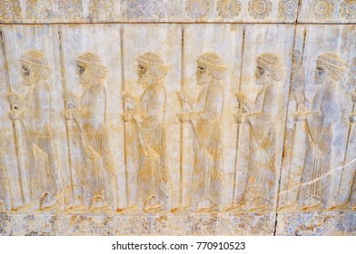 PERSEPOLIS, IRAN - OCTOBER 13, 2017: The relief on the wall of Eastern Stairway of Apadana palace in Persepolis depicts the soldiers, dressed as civilians, on October 13 in Persepolis.