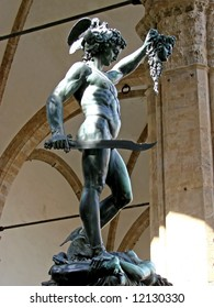 Perseus, with a curved sword, a gift of Mercury, wears winged sandals, like Mercury's, and a helmet with wings (resembling Mercury's hat).