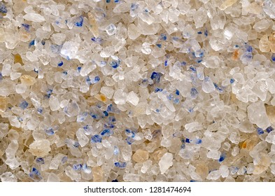 Persian Blue Salt crystals closeup, surface and background. Fine rock salt from Iran. Blue color occurs during forming the crystalline structure, caused by an optical illusion. Seasoning. Macro photo.