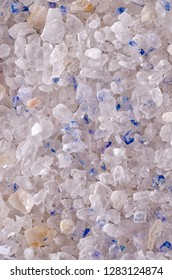 Persian Blue Salt crystals surface, macro photo. Fine rock salt from Iran. Seasoning. The intriguing blue color occurs during the forming of the crystalline structure, caused by an optical illusion.