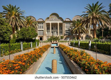 Persian garden of Eram with its beautiful pavilion, traditional Iranian fountain system and Palm trees in city of Shiraz, Iran.