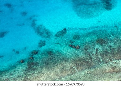 Persian Gulf, rocky seabed is under blue shallow water. Natural photo. Bird eye view