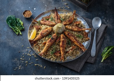 Persian herbed rice sabzi polo with fried red mullet, copy space