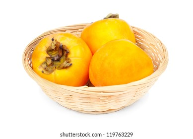 Persimmon fruit in fruit basket on white background