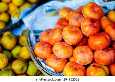 Persimmon fruit on basket from market.