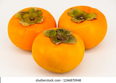 Persimmon isolated in white blur background