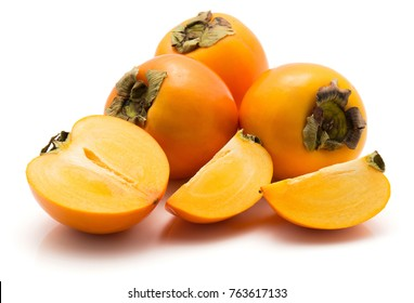 Persimmon Kaki isolated on white background three whole one half two slices