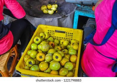 Persimmons in a basket in Hsinchu, Taiwan.