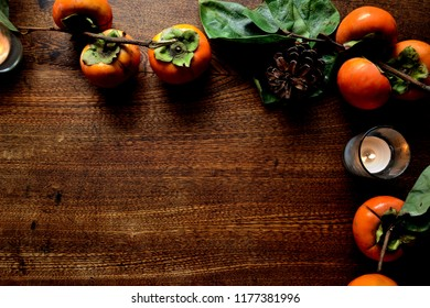 Persimmons with candle light