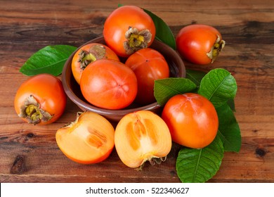 Persimmons kaki fruits on old wooden