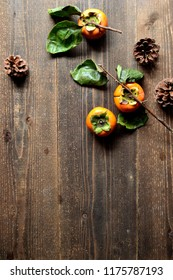 Persimmons with pine cone