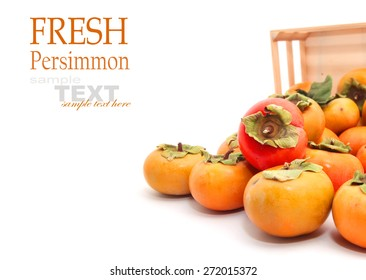 Persimmons in the wooden box isolated on white background