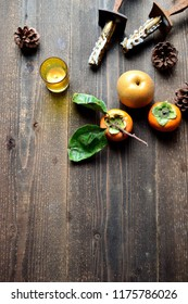 Persimmons,pear and candles