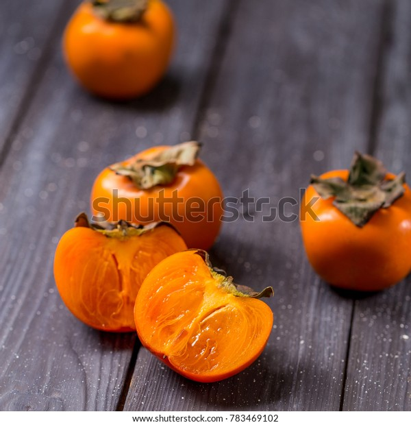persimon at black background fruits orange