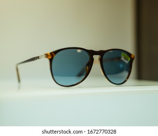 Persol 714 Foldable Sunglasses in white display case, tortoise frames with blue lens, taken while displayed at São Jorge Cinema, Lisbon, Portugal, in October 15th 2019
