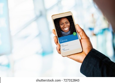 person from address book on smartphone. African woman