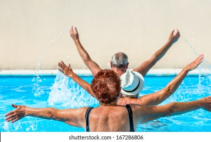 person aged group doing water aerobics in a swimming pool during a spa treatment