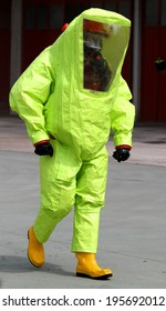 person with anti radiation suit yellow and yellow rubber boots to guard against the risk of bacteriological and chemical biological attack