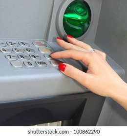 Person at an ATM making a money withdraw password