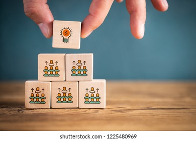 person with the best ideas gets to the top, symbolized by icons on stacked cubes