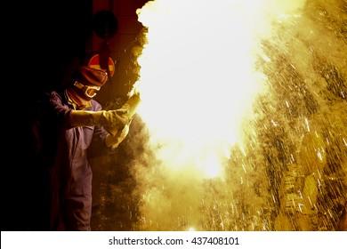 A person blows up a big firecracker and creates a gigantic blaze bright.