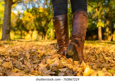 Person with boots walking at autumn