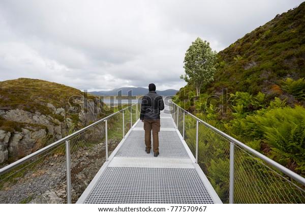 A person at the bridge