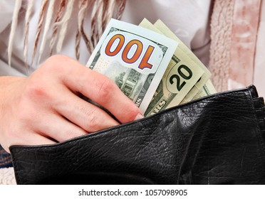Person checking the Wallet with a Money closeup