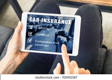 Person choosing car insurance coverage options (liability, collision, comprehensive) on website on digital tablet computer screen, vehicle and risk protection