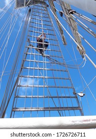 A Person Climbing Mast on a Sailing Ship in the Atlantic Ocean near Cape Verde Islands, Africa