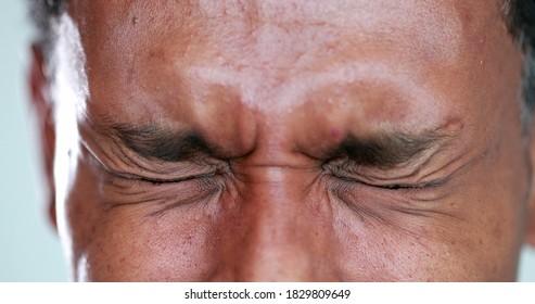 Person close-up eyes closed feeling upset feeling emocional, squinting eyesight