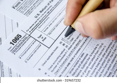 Person completing 1065 tax form