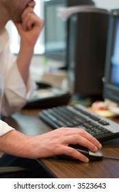 Person at computer and keyboard