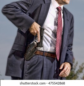 Person with a concealed carry permit starting to draw his handgun