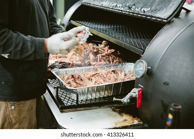 person cooking bbq