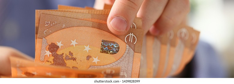 Person Counting Money Savings Finance Concept. Caucasian Businessman Holding Euro Cash in Hand. Business Financing Accounting. Accountant Man Check Wealth Balance and Growth. Tax, Bill Payment