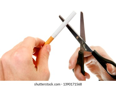 Person cutting a Cigarette with Scissors on the White Background closeup