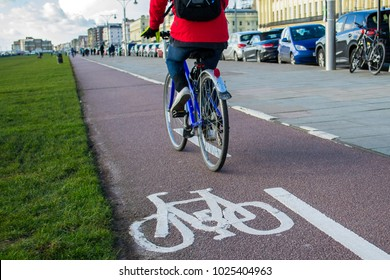 Person cycling on a bike path in the city