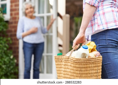 Person Doing Shopping For Elderly Neighbor