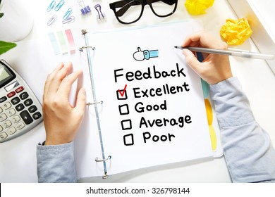 Person drawing Feedback concept on white paper in the office