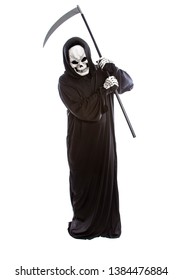 Person dressed in grim reaper or death ghost Halloween costume pretending to play golf with a scythe.