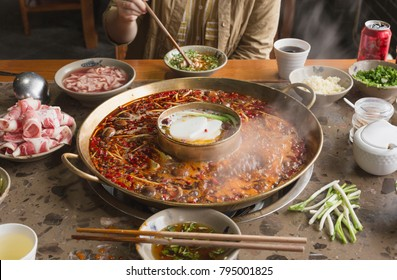 A person is eating hotpot scene