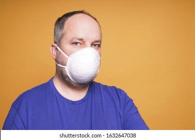 person with face mask or dust mask or filtering facepiece respirator or breathing protection - virus outbreak or air pollution concept
