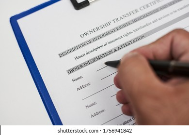 A person filling ownership transfer certificate document