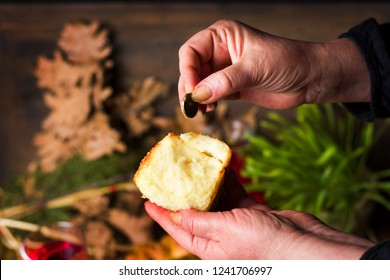 Person finding coin in Orthodox Christmas eve bread