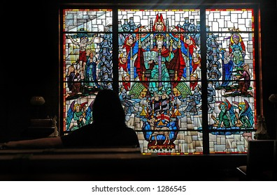 Person in front of a stained glass window