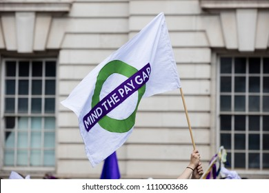 A person with a gender pay equal banner at a political protest march