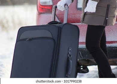 A person goes on a journey. By car in the winter.